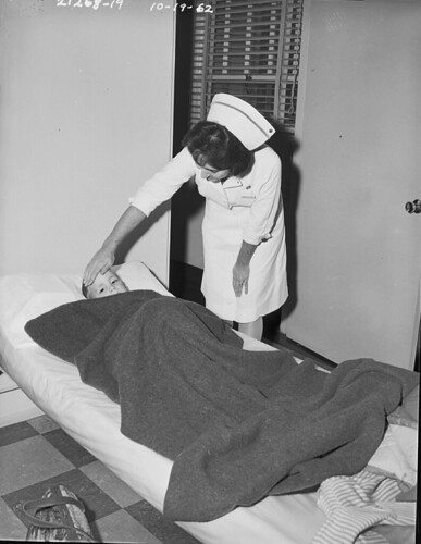 Nurse with sick boy, 1962