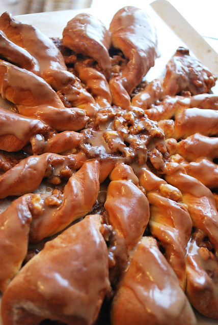 Maple Twists - a maple flavored dough with a cinnamon sugar nut mixture twisted inside and drizzled with a maple glaze.
