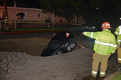 Firefighters Rescue Woman From Sink Hole in Studio City