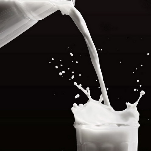 Pouring milk | Pouring milk from the bottle to the glass ...