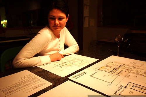 rachel looks at architectural drawings    MG 6016