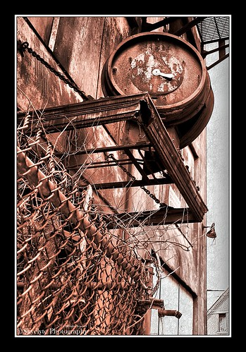 old city urban clock metal sepia architecture fence chains weeds rust factory antique chainlink forgotten hdr decayed waterburyclockcompany