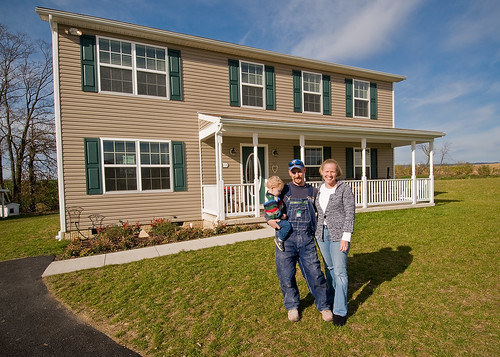 Peter, Sarah and PJ Riggio pose for a photograph in front of their new home in Newville, Pennsylvania. The Riggios were able to purchase their home with a loan from the United States Department of Agriculture, Rural Development, Self-Help Housing Loan Program.