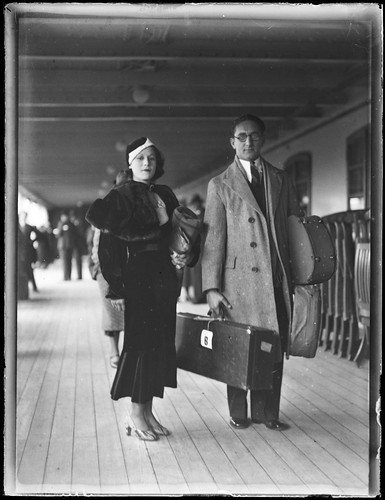 Man and woman [Eric Sheldon and wife?] on ship deck
