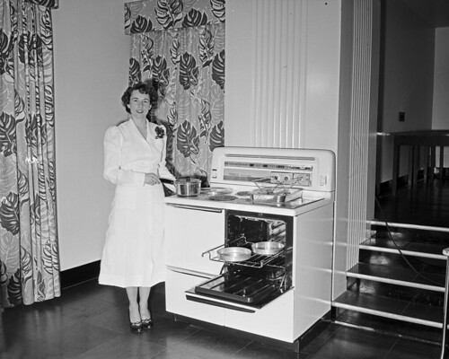 Marilyn demonstrating electric stove, 1949