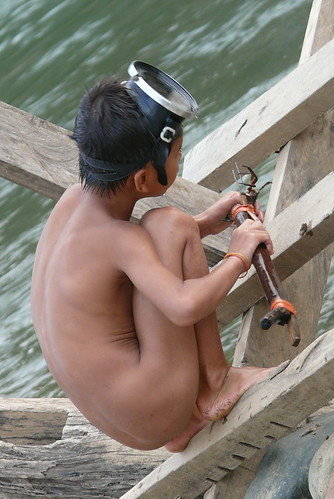 Lil kid fishing in the Mekong