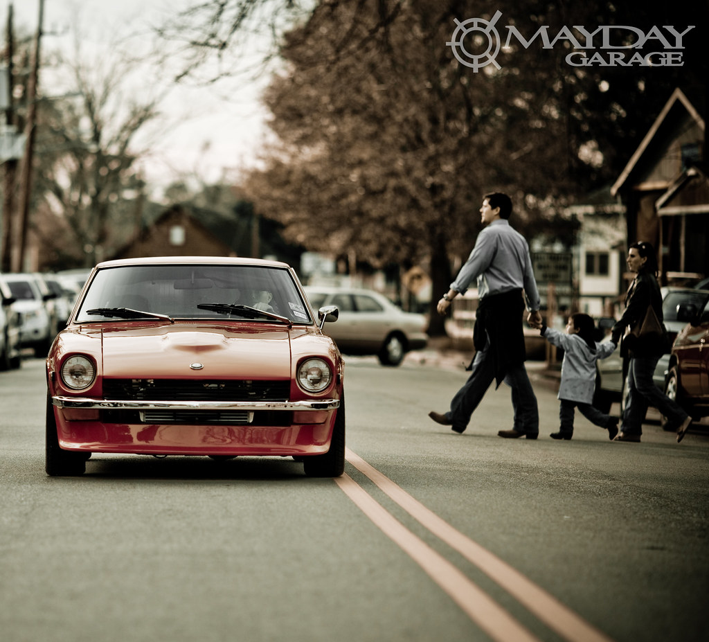 In Old Town Spring, TX, a 240Z is part of the background.