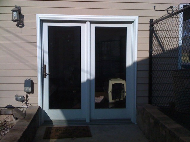 Trim replaced around patio door i am having the wood for Wood trim around doors