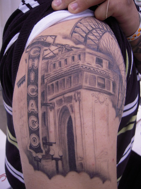Michael Daddio shows part of his tattoo sleeve which includes the Chicago