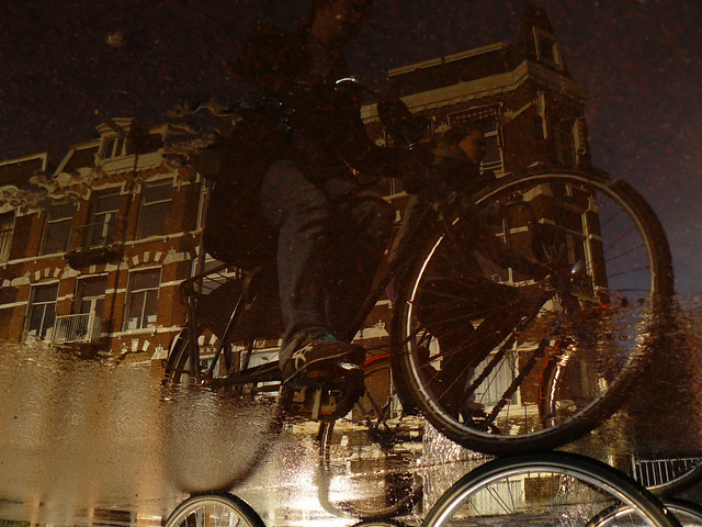Reflections Of Amsterdam - Puddle Floating