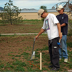 John Bird (left) and Tom Hamilton mark a tee pad for Schaefer Disc Golf Course.