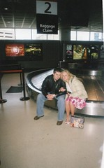 Will & Britt at the airport on their honeymoon with lost luggage