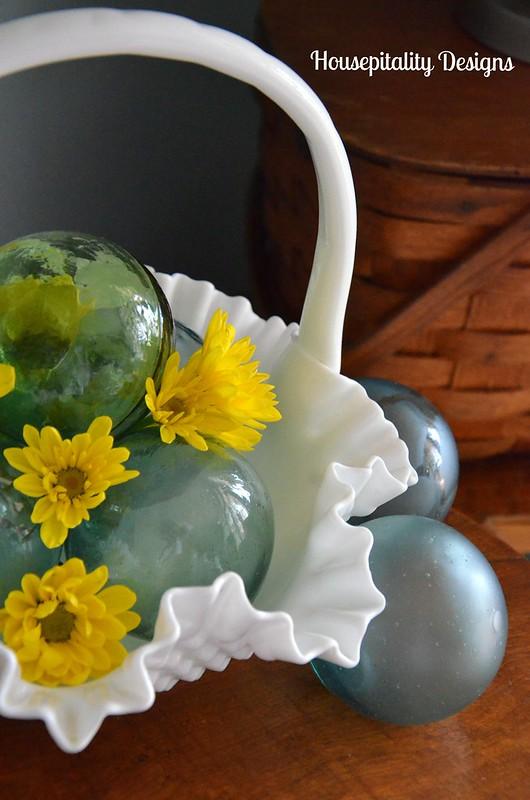 Milk glass basket w/vintage glass fishing floats