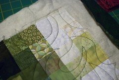 1 Nov 2009 - 19:32 - The three layers are now anchored together with overall stitching (the quilting).  Next task: cut the quilt free of the excess batting and fabric, then close off (bind) the edges.