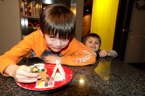 nick shows off his gingerbread house and gingerbread man
