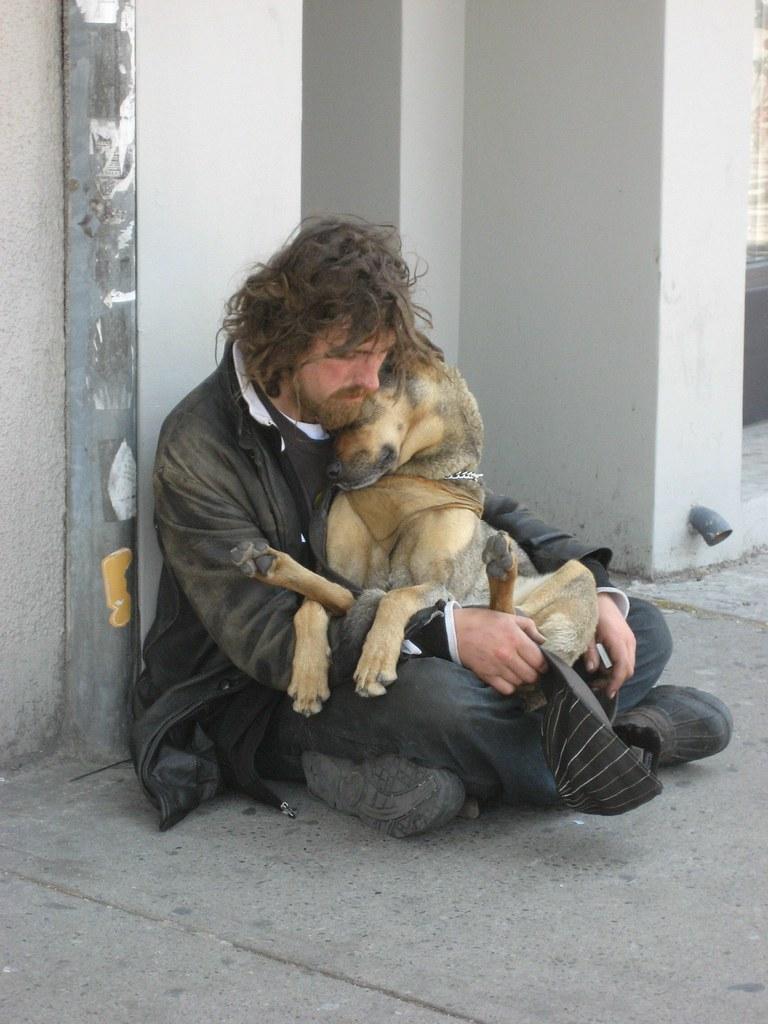 Homeless cuddling dog by Kirsten Starcher
