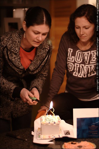 lighting the candles on neeta's birthday cake