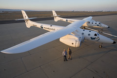 Burt Rutan and Sir Richard Branson stand before VMS Eve after she is rolled out in Mojave, July 08. Credit Mark Greenberg