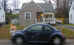 sedan(0.0), automobile(1.0), volkswagen beetle(1.0), automotive exterior(1.0), wheel(1.0), vehicle(1.0), volkswagen new beetle(1.0), subcompact car(1.0), city car(1.0), land vehicle(1.0),