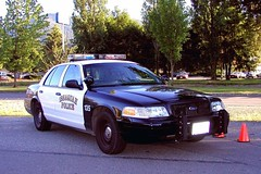 police(0.0), automobile(1.0), automotive exterior(1.0), law enforcement(1.0), ford crown victoria police interceptor(1.0), vehicle(1.0), police car(1.0), full-size car(1.0), compact car(1.0), ford(1.0), sedan(1.0), ford crown victoria(1.0), land vehicle(1.0), luxury vehicle(1.0), vehicle registration plate(1.0), motor vehicle(1.0),