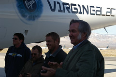 Burt Rutan and team congratulate the pilots following VMS Eve's successful maiden flight.  Credit Freddie Weston-Smith