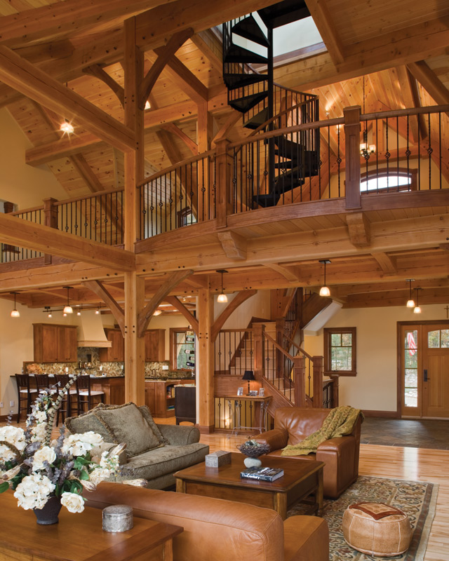 Timber treasure timber frame home great room loft for Timber frame great room