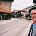 An elderly man waits for a tram in Sarajevo
