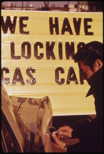Sales of Gasoline Tank Locks Increased Dramatically During the Fuel Crisis in the Pacific Northwest, and Their Prices Doubled. A Gas Station Attendant Is Shown Unlocking a Customer's Tank 01/1974