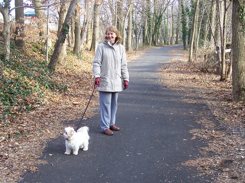 A lady walking her dog on the Catonsville #8 Trolley Trail