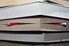 Red pencil sticking out between pages of a book by Horia Varlan