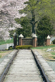 Belmont Abbey College sign facing trail