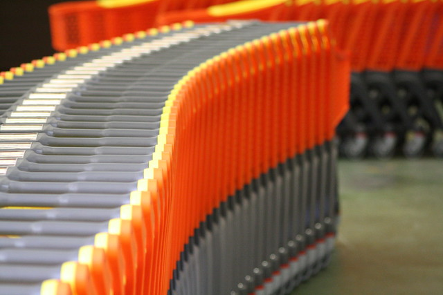 Many Nested Orange Plastic Shopping Carts.