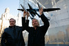 Burt Rutan and Sir Richard Branson photographed holding models of VMS Eve and SpaceShipTwo.