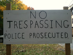 Unintended humor. Sign reading: No Trespassing. Police Prosecuted.