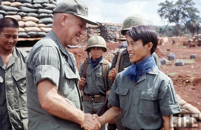 Gen. Creighton Abrams shaking hands w. a Vietnamese soldier - August 1967