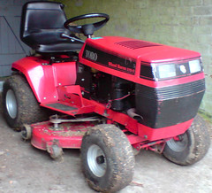 agricultural machinery(0.0), city car(0.0), light commercial vehicle(0.0), outdoor power equipment(1.0), riding mower(1.0), automotive exterior(1.0), wheel(1.0), vehicle(1.0), bumper(1.0), lawn mower(1.0), land vehicle(1.0), tractor(1.0),