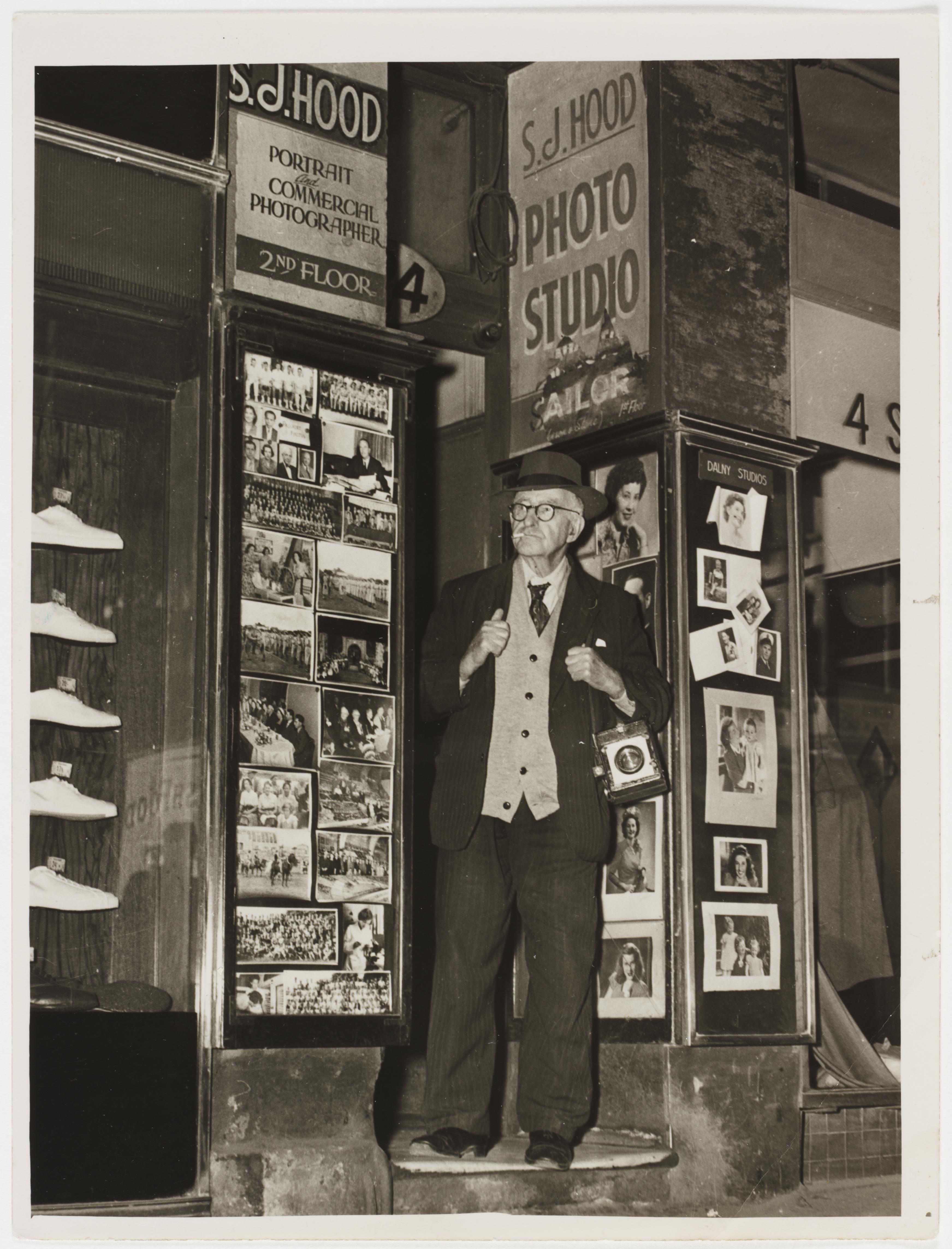 Sam Hood outside his Dalny Studios, 124 Pitt Street, Sydney, 1953 / photographer Ted Hood