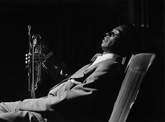 Miles Davis resting backstage, at the Shrine Auditorium, Los Angeles, 1950, by Bob Willoughby