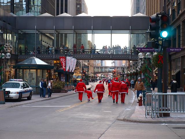 Legal Aid Santas down Nicollet Mall
