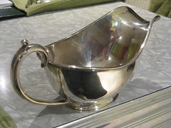 cup(0.0), drinkware(0.0), saucer(0.0), glass(0.0), iron(0.0), serveware(1.0), metal(1.0), tableware(1.0), silver(1.0),