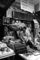 Trinket stall and its owner