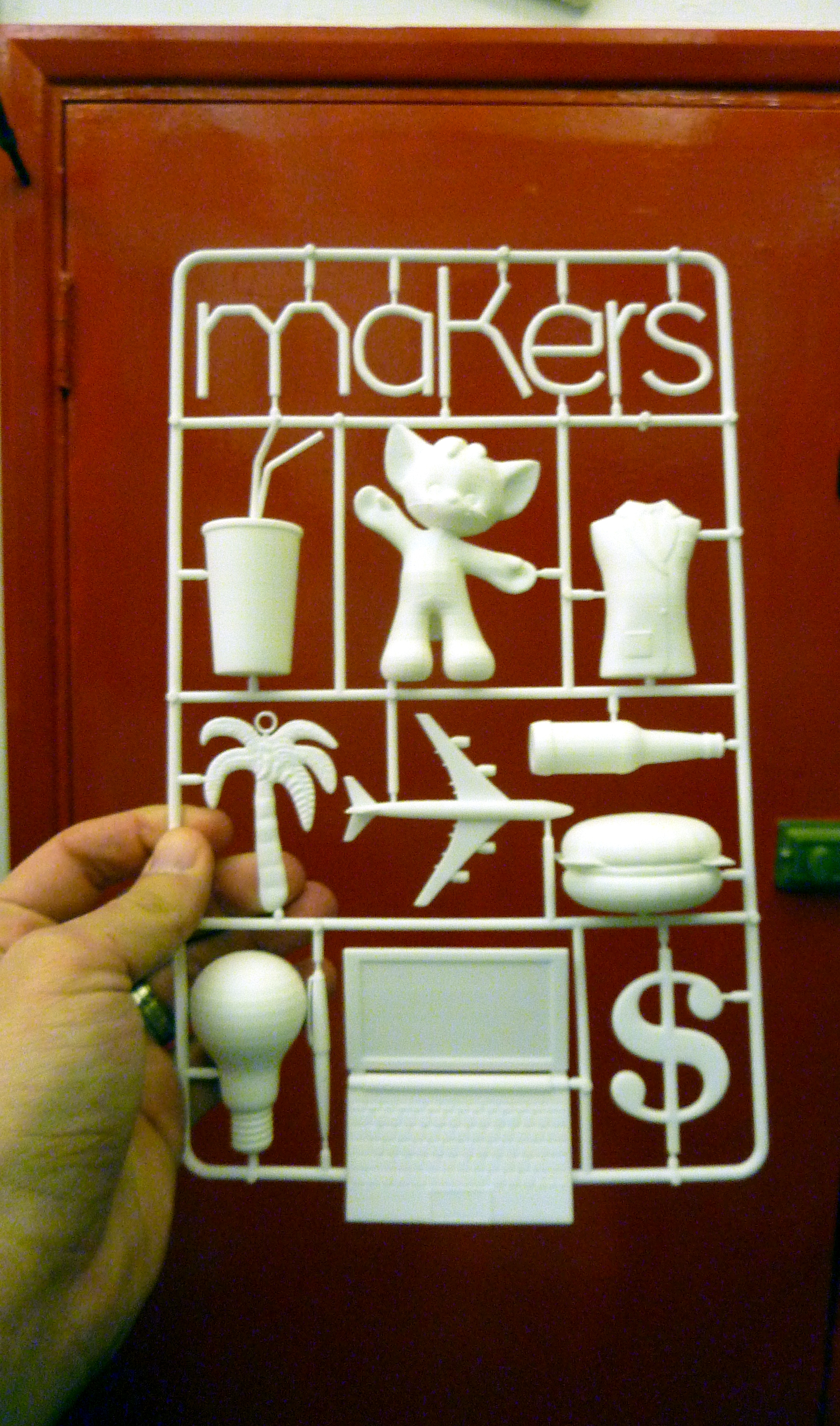 3D model of the UK HarperCollins cover for Makers (front) with my hand, courtesy of Shapeways, the office, Clerkenwell, London, UK