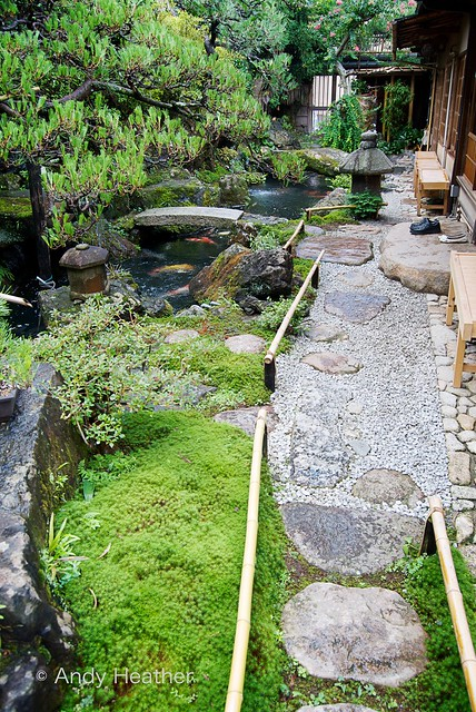 Kyoto Japanese Garden With Koi Carp Pond And A Pair Of