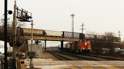 BNSF Railway intermodal switching movement passing underneath a westbound Canadian National freight train. Berwyn Illinois. February 2010. by Eddie from Chicago