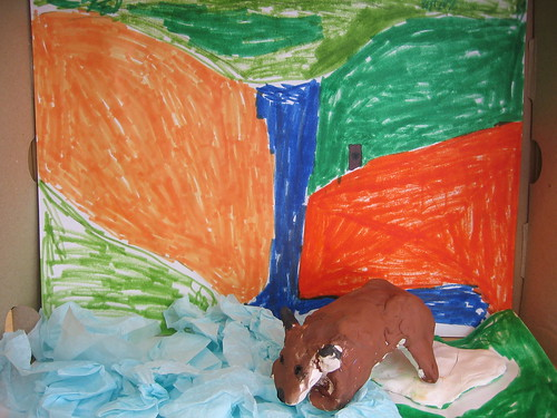 A diorama of Buddy Bison in front of a water fall
