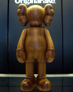 "KAWS x Original Fake - ""Karimoku"" Wood Companion"