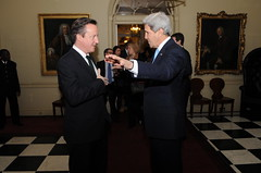 British Prime Minister David Cameron bids farewell to U.S. Secretary of State John Kerry following at meeting at No. 10 Downing Street in London, United Kingdom, on March 14, 2014. [State Department photo/ Public Domain]