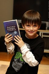 nick with an artemis fowl book