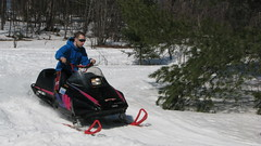 sledding(0.0), sled(0.0), auto racing(1.0), racing(1.0), winter sport(1.0), vehicle(1.0), sports(1.0), snow(1.0), motorsport(1.0), snowmobile(1.0), land vehicle(1.0),