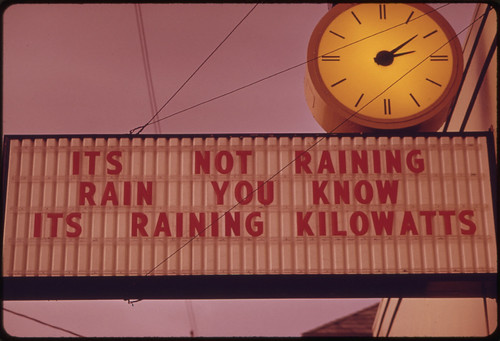 Lack of Rain Turned Into a Message on an Outdoor Advertising Sign, Asking People to Conserve Their Energy Output During the Fuel Crisis in Late 1973 in the Pacific Northwest 12/1973